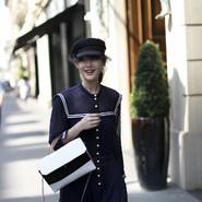 陈燃现身巴黎时尚活动 简约针织裙轻松穿出时髦